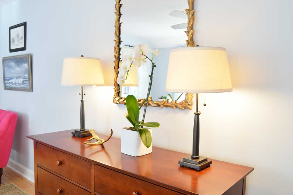 Dresser with Decorative Mirror and Lamps