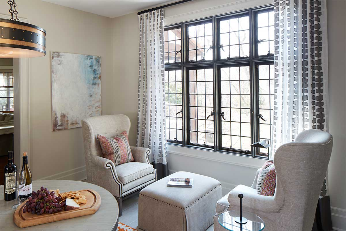 Sunroom-with-Tan-Chairs-and-Patterned-Curtains